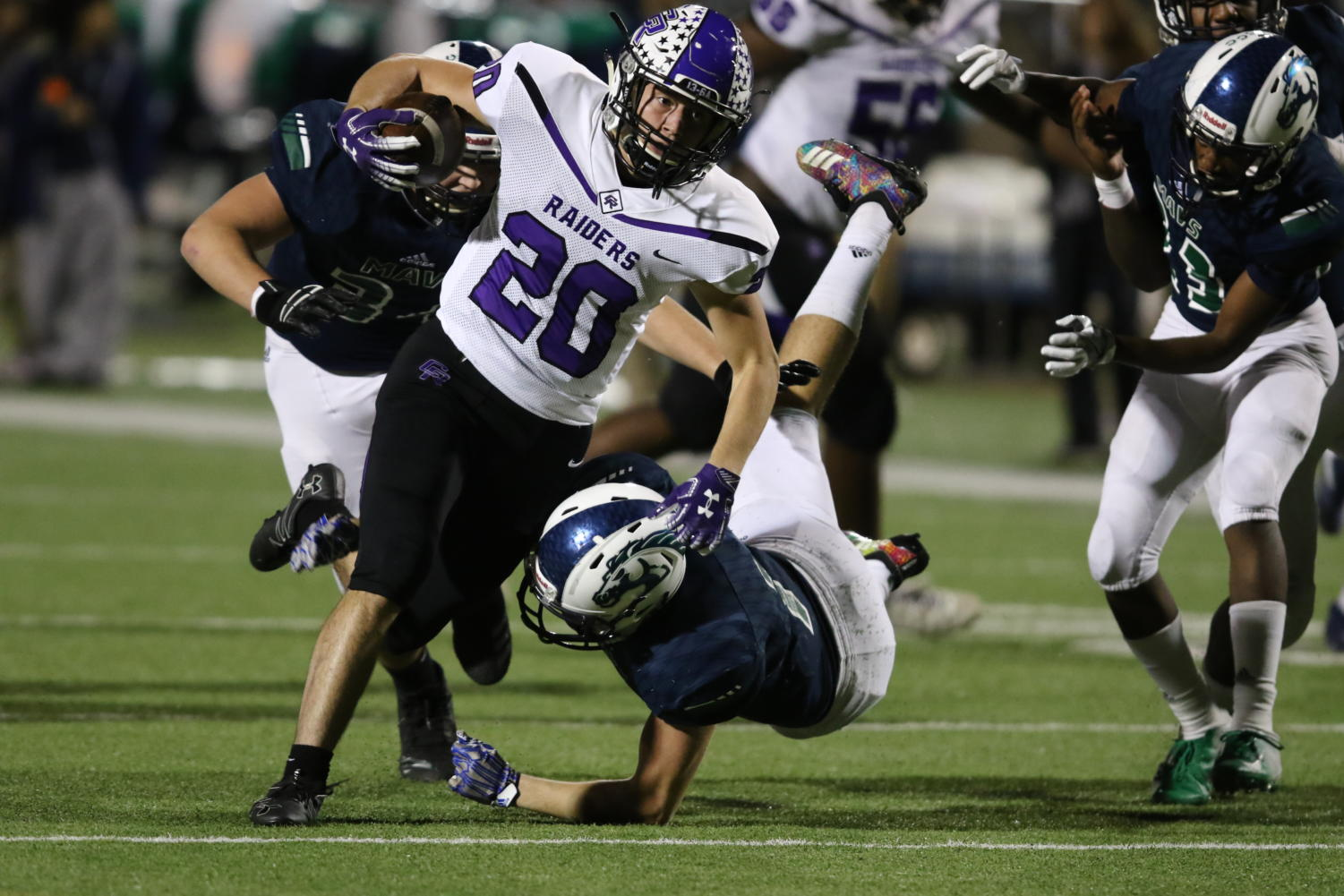Jed Kennis (12) breaks through the secondary in the game against the McNeil Mavericks.
