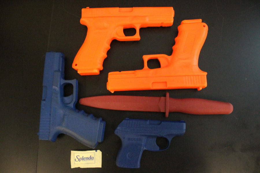 Weapon props are not real and used only for practicing searches.  Splenda packet represents illegal drug.