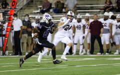 Joshua Nazaire (12) runs for a touchdown in Friday night's victory over Round Rock.