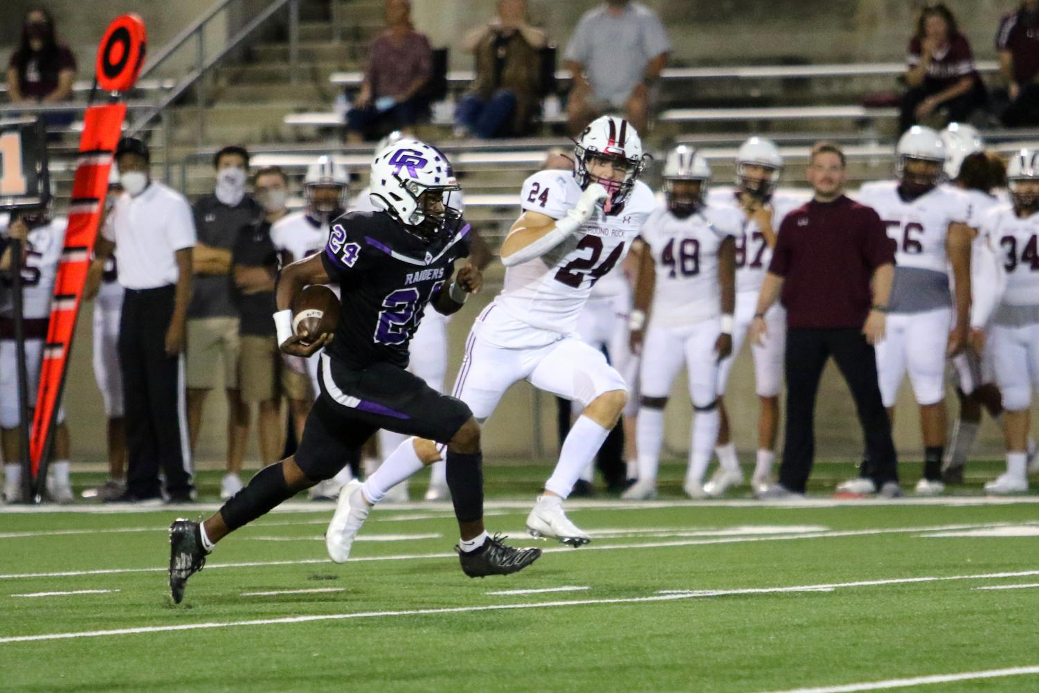 Joshua Nazaire (12) runs for a touchdown in Friday nights victory over Round Rock.